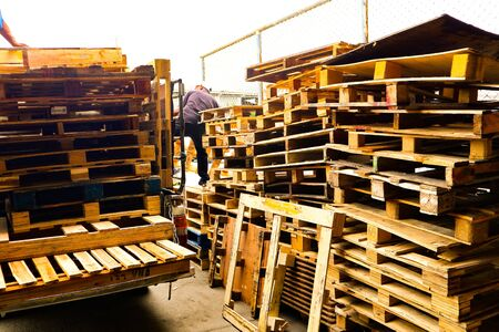 Wooden pallets stack at the freight cargo warehouse for transportation and logistics industrial Stock fotó