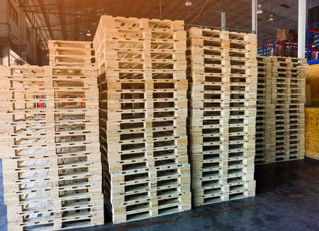 Wooden pallets stack in warehouse cargo storage, shipment in logistics and transportation industrial, wood pallets heap, delivery service 스톡 콘텐츠 - 155442369