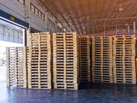 Wooden pallets stack in warehouse cargo storage, shipment in logistics and transportation industrial, wood pallets heap, delivery service 스톡 콘텐츠 - 155441822