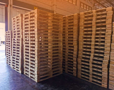 Wooden pallets stack in warehouse cargo storage, shipment in logistics and transportation industrial, wood pallets heap, delivery service