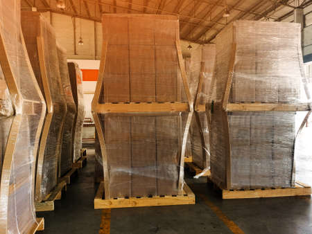 Worker driving forklift loading shipment carton boxes goods on wooden pallet at loading dock from container truck to warehouse cargo storage in freight logistics, transportation industrial, delivery 스톡 콘텐츠