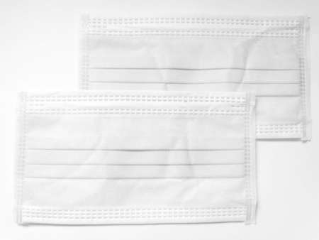 White surgical face mask on white background, Health care concept and can protect virus covid-19, medical masks, fabric mask protect air pollution
