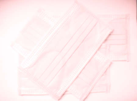 Light pink surgical face mask on white background,  Health care concept and can protect virus covid-19, medical masks, fabric mask protect air pollution