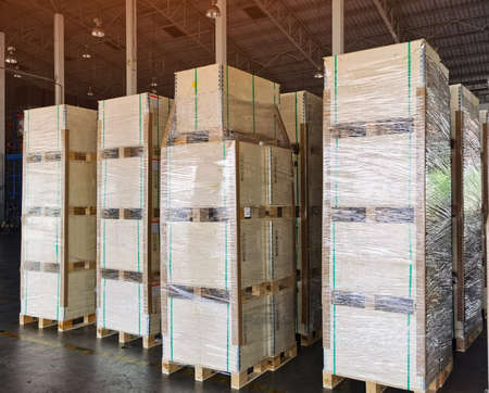 Shipment cartons box on pallets and wooden case on hand lift in interior warehouse cargo for export and sorting goods in freight logistics and transportation industrial, delivery service 스톡 콘텐츠