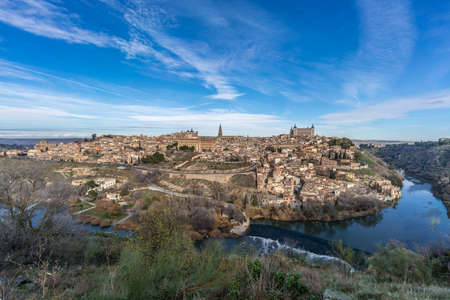 Toledo Skyline, cathedral, Alcazar and the (Tajo) tagus river surrounding the city. Stock Photo