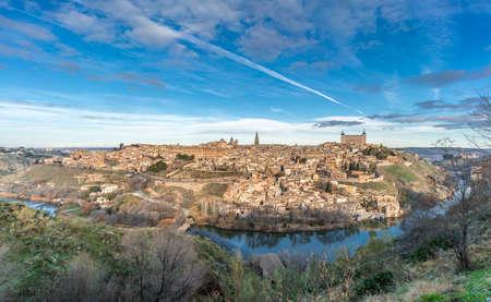 Toledo skyline. Alcazar and the (Tajo) tagus river. UNESCO world heritage site. Stock Photo