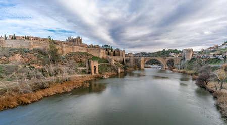 View of Toledo walls, Monastery of San Juan de los Reyes and Puente de San Martin Bridge over the (Tajo) Tagus River