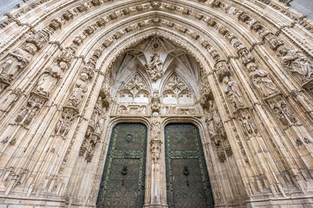 Tympanum carvings detail of Puerta de los leones (Lions Gate) at Catedral de Toledo (Toledo Cathedral). Castile La Mancha, Spain
