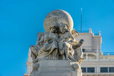 5 female figures, representing the 5 Continents, read Don Quixote, symbolizing the universal dissemination of the novel. Top of the monument to Cervantes at Plaza de España Square, Madrid, Spain
