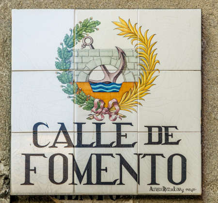 Madrid, Spain - April 12, 2017. Traditional handmade ceramic tiles street sign. Located in historic center of Madrid. Calle de Fomento