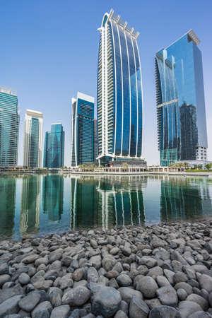 Dubai, July 07, 2014. Jumeirah Lake Towers (JLT)  reflected on the Almas Lake.