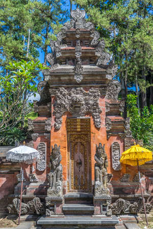 Dvarapala Guardian, Carved stone sculpture  at Pura Tirta Empul temple. Famous for its Holy Spring Waters Located in Tampaksiring, Bali, Indonesia Stock Photo