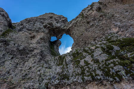 Eroded stone arch know as Ventana del nublo or La Agujereada. One of the higest places in Gran Canaria Island, Spain