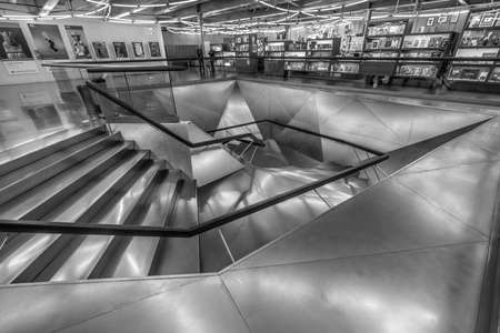 Madrid, Spain. January 9, 2017. CaixaForum Madrid museum entrance metal staircase and shop.