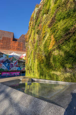 Madrid, Spain. January 9, 2017. CaixaForum Madrid museum entrance. Originally a power plant it was designed by architects Herzog & De Miron. The facade vertical gardens were designed by Patrick Blanc. Editorial