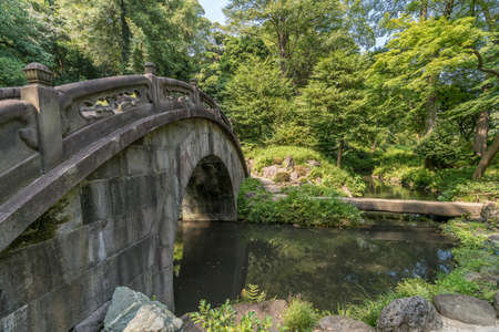 Engetsu-kyo stone bridge at Koishikawa Korakuen Garden. The origin of the Name Engetsukyo which literally means Full Moon is because the reflections of the arch on the water form a full moon. Located in Bunkyo Ward, Tokyo, Japan Stock Photo