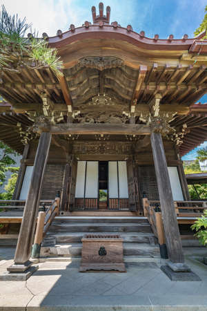 Kamakura, Japan - August 31, 2018 : Main Hall of Daikoji temple. Buddhist temple of Shingon sect.  Dedicated to painless childbirth, safe pregnancy and easy baby delivery.