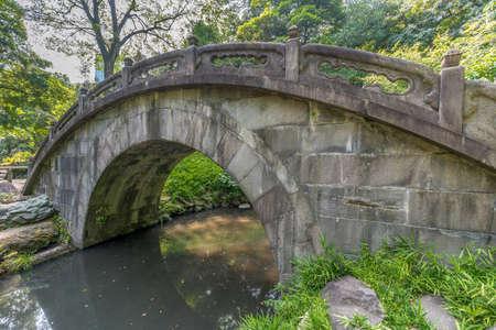 Tokyo, Bunkyo Ward - August 04, 2018 : Engetsu-kyo stone bridge at Koishikawa Korakuen Garden