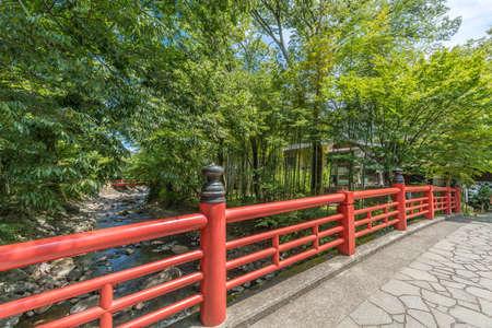 Izu, Shizuoka, Japan - August 10, 2018 :  Kaedebashi Bridge over the Kitamata river in the Shuzenji hot spring area of Izu City Editorial