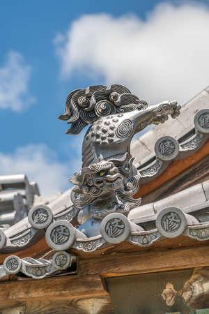 Izu, Shizuoka, Japan - August 10, 2018 : Komainu or Shishi gargoyle roof ornament at Shuzenji Temple