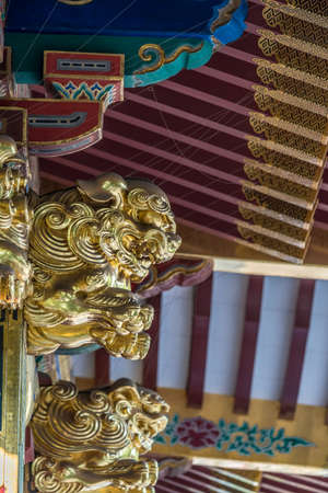 Tokyo - August 6, 2018 : Wooden carved Shishi Lion Nosing ornament at Honden (Main Hall) of Nezu Jinja Shinto Shrine. Ishi-no-ma-zukuri style of Shinto architecture. Important Cultural Property 에디토리얼