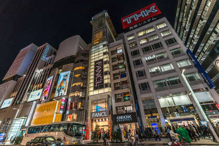 Ginza, Tokyo - December 2017 : Start of Christmas season in crowded Chuo dori street at Ginza luxurious shopping District by night.