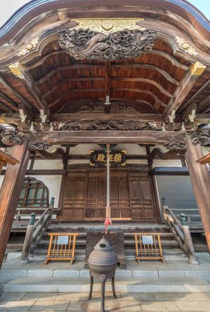 Tokyo - August 6, 2018 : Suzu hanging bell and Jokoro, Dragon shaped Shishi nosing at Honden Main Hall of Daienji Small nichiren buddhist sect temple. Located in Yanaka