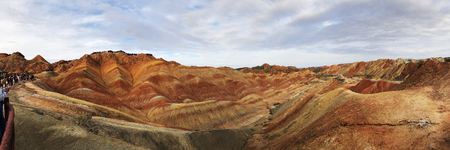 Panorama View of Rainbow Mountains Geological Park. Stripy Zhangye Danxia Landform Geological Park in Gansu Province, China. Valley on a Sunny Day.