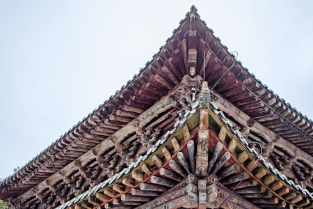 Wooden Traditional Chinese Roof Of Pagoda. Roof Structure Of Buddhist Temple. Oriental Architecture Of Kumbum Monastery in Xining.