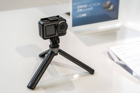 CHINA, SHANGHAI - MAY 18, 2019. DJI OSMO ACTION IN PROTECTED CASE AND TRIPOD OR SELFIE STICK.