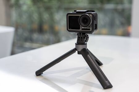 CHINA, SHANGHAI - MAY 18, 2019. DJI OSMO ACTION IN PROTECTED CASE AND TRIPOD.