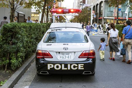 TOKYO, JAPAN - OCTOBER 6, 2018. Japanese Police Patrol Car Is Doing Civil Servant For Public Safety In The Crowd.