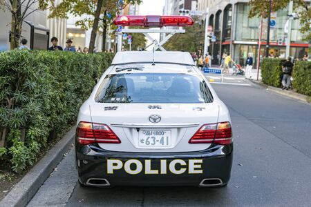 TOKYO, JAPAN - OCTOBER 6, 2018. Japanese Police Patrol Car Is Doing Civil Servant For Public Safety.