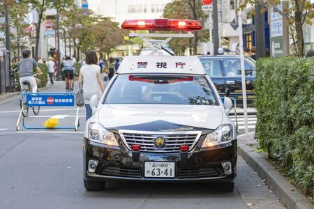 TOKYO, JAPAN - OCTOBER 6, 2018. Signal Light Is On The Japanese Police Patrol Car. Light Alarm Is Blinking At Upper Setting Position.