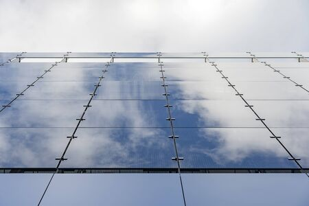 Glass And Aluminum And Blue Sky And Modern Architecture. Clouds Are Reflecting In The Glazing Facade And Aluminium Panels. Stockfoto