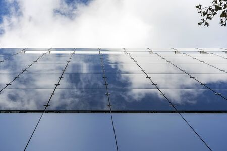 Glass And Aluminum And Blue Sky And Modern Architecture. Clouds Are Reflecting In The Glazing Facade And Aluminium Panels. Banque d'images