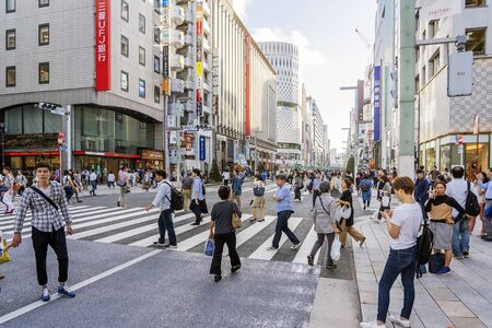 TOKYO, JAPAN - OCTOBER 6, 2018. People Are Crossing Ginza Street In Tokyo, Japan. Pedestrian Street During Holidays Free Out Of Cars.