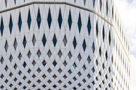 Closeup View Of White Panels And Parametric Facade. Building Made From Stretched White Tile. 写真素材