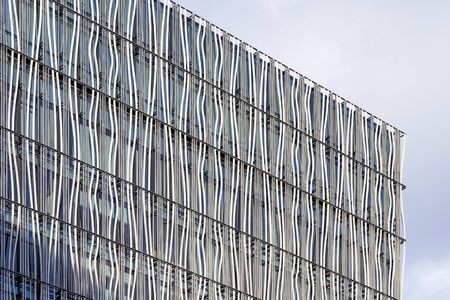 Closeup View Of Curved Louvers Cover Facade Of Building And It Creates Extra Shadows. Zdjęcie Seryjne