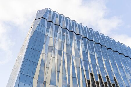 Glass Crystal Windows. Clear Glass Curtain Wall. Top of Spandrel Facade System. Corner and Parapet of Modern Building.