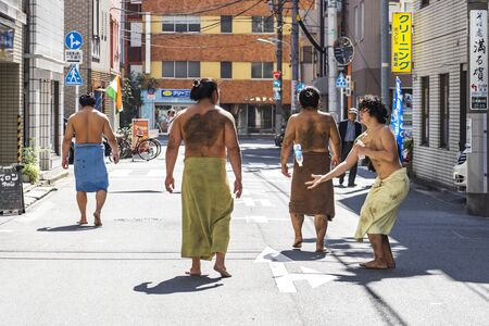 TOKYO, JAPAN - OCTOBER 7, 2018. Japanese Sumo Wrestlers are Having Fun on a Street After Their Training.