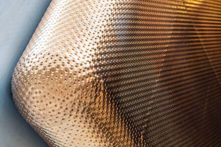 Closeup View of Well Welded Round Edge Corner of Bronze Panels. Golden Color Textured Cladding Facade. Stockfoto