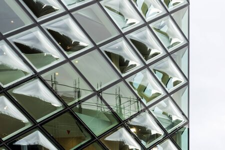 Close-Up View of Double Curve Convex Glass Windows. Clear Glazing Facade System. The bubbles of Glass Panels and Reflection.