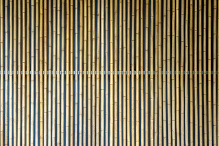 Texture of Yellow Bamboo Wall. Decoration Facade Made from Bamboo.