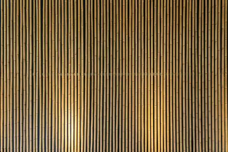 Bottom Lighting of Yellow Bamboo Wall. Stockfoto