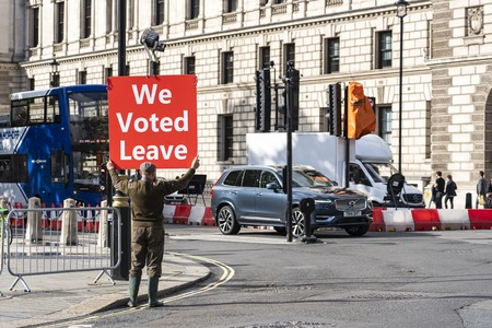 LONDON, UNITED KINGDOM - OCTOBER 1, 2019. Farmer is Holding the Red Banner on the Parliament Square Supporting Brexit - We Voted Leave. Redactioneel
