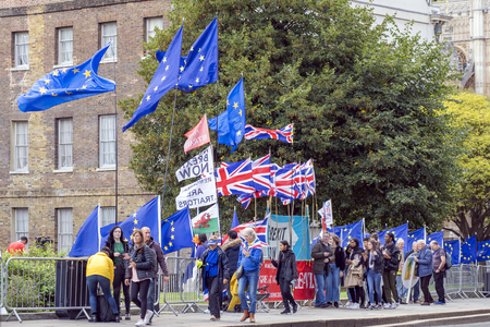 LONDON, UNITED KINGDOM - OCTOBER 1, 2019. People are Gathering and Having Rally Bunch Of Flags of European Union and Great Britain. Redactioneel