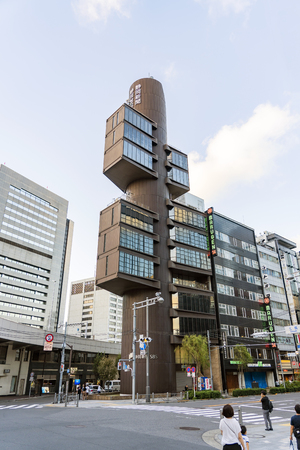 TOKYO, JAPAN - OCTOBER 6, 2018. Famous Shizuoka Press & Broadcasting Center building Designed by Kenzo Tange in the Ginza District of Tokyo.