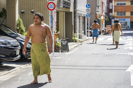 TOKYO, JAPAN - OCTOBER 7, 2018. Japanese Sumo Wrestlers are Having a Walk on a Street After Their Training.