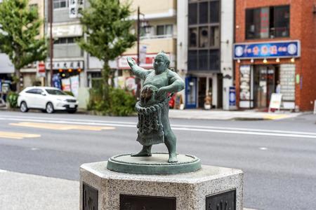 TOKYO, JAPAN - OCTOBER 8, 2018. The Bronze Figure Statue Of Japanese Sumo Wrestler on the Street.